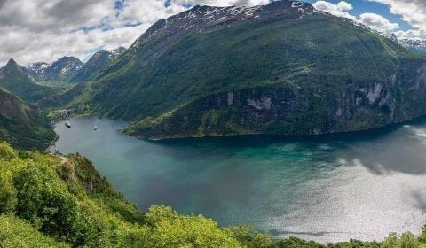 Panoramic view over the Geirangerfjord from the Eagle Road, traveling towards the Herdal Farm