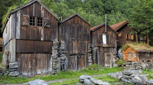 Old wooden cabins on the road side in the mountains towards the Herdal Goat Farm in Geiranger