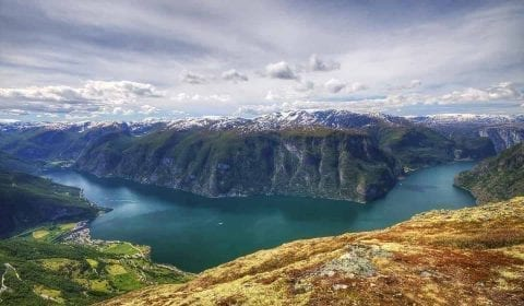 Panoramic view from Huaren over the Innvikfjord, a branch of the Nordfjord, and the villages of Olden and Loen