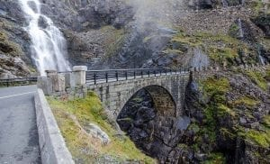 Stone bridge, part of the Troll Road, crossing spectacular Stigfossen waterfall