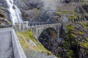 Stone bridge, part of the Troll Road, crossing spectacular Stigfossen waterfall