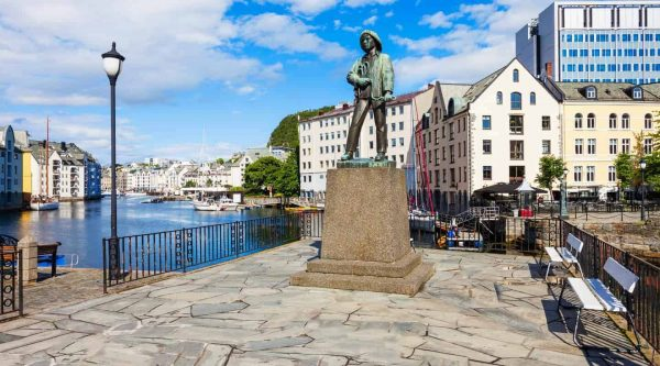 Statue of Fiskergutten, fisherman's son, at the Brosund canal in the Art Nouveau city of Ålesund, Norway.