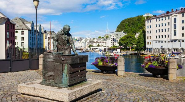 Sildekona, the herring wife statue, in Alesund city centre in More og Romsdal county, Norway