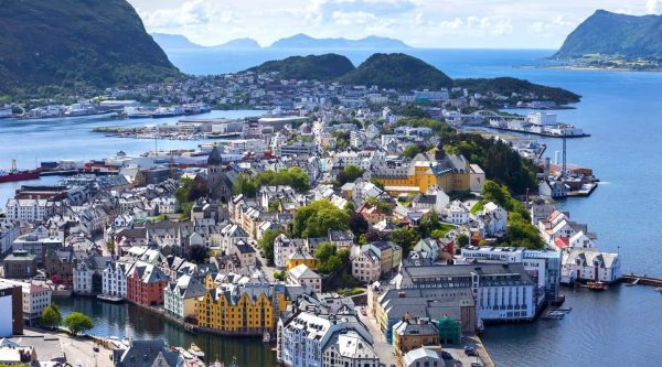 View from Mount Aksla over the center of Ålesund, colourful Art Nouveau buildings on several islands, peacefully surrounded by the Atlantic Ocean