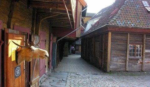 Wooden houses in a narrow street in the Hanseatic quarter of Bryggen in Bergen, Norway