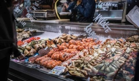 11Fresh crabs, shrimp and other seafood on display at the Fish Market in Bergen, Norway