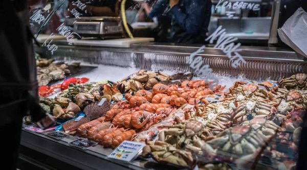 Fresh crabs, shrimp and other seafood on display at the Fish Market in Bergen, Norway