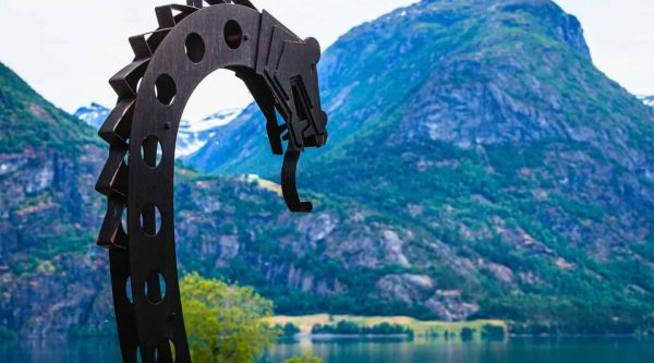 Viking dragon, detail from a viking boat, at the lake of Oppstrynsvatnet on the road to Geiranger, Norway