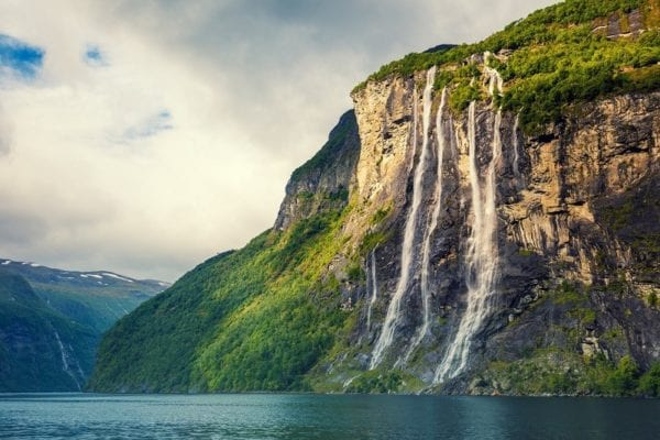 The Seven Sisters waterfalls flowing into the Geirangerfjord