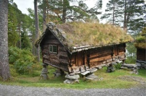 A traditional Norwegian wooden building with grass roof at the Sunnmøre Museum in Ålesund, Norway