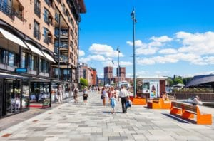 The bustling Aker Brygge in Oslo, Norway on a summer day.