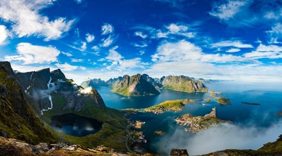 A view of mountains emerging from the ocean in Lofoten, Norway.