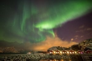 The Northern lights over a fishing village near Leknes, Norway.