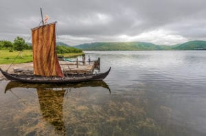 Reconstructed Viking ships in the lake at Vestvagoy. The area is a part of Lofotr Viking museum.