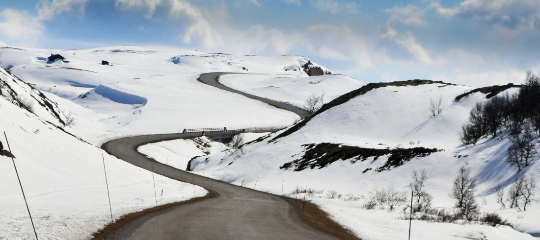 a windy road through a snowy landscape to get to a cabin, Norway.