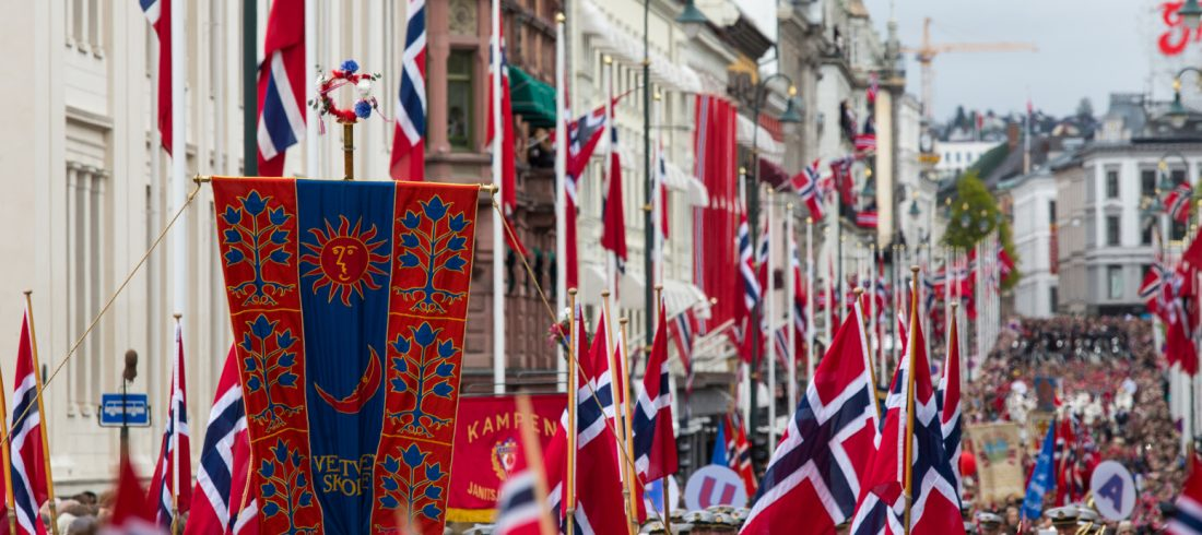 A close up view from the crowd marching in the Syttende Mai parade in Oslo, Norway pre-pandemic.