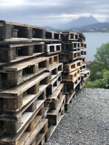 Pallets stacked up in preparation to build the Slinningsbålet bonfire.