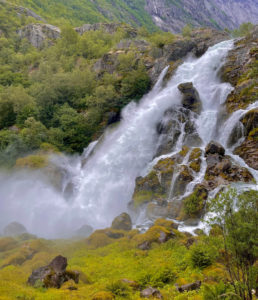The powerful and beautiful waterfall of Kleivafossen in Norway.