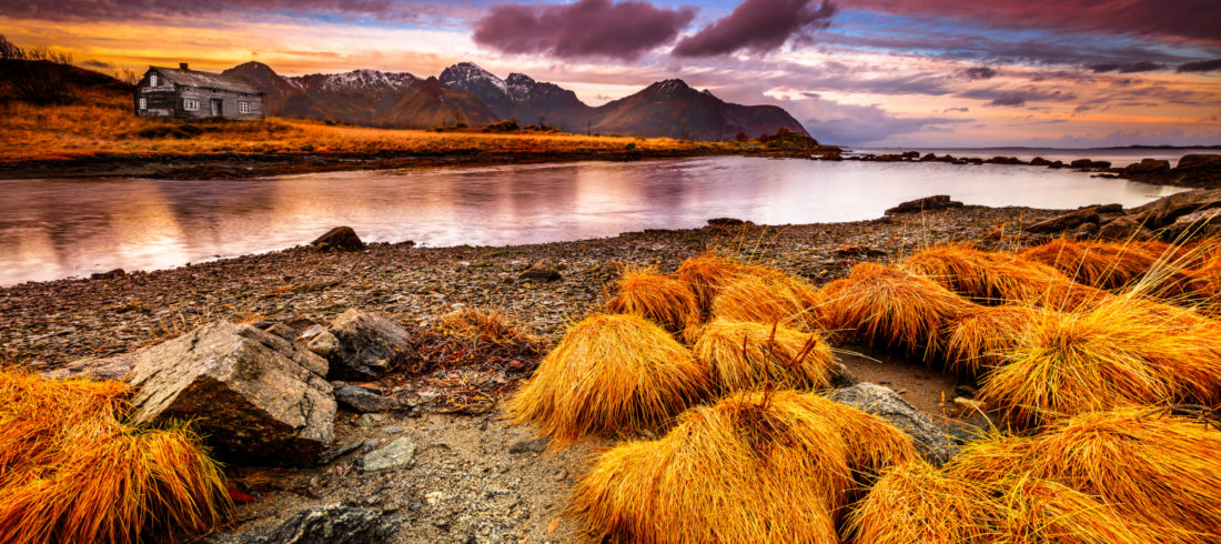 Beautiful fall landscape of Vestvågøy, Norway with a dramatic pink sunset