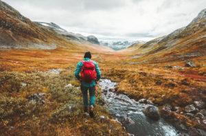 A man hiking in the fall season in Norway